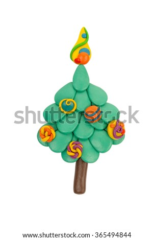 Christmas tree from plasticine.Isolated on a white background.Handmade.Toy for baby.The vertical location of the photo. - stock photo