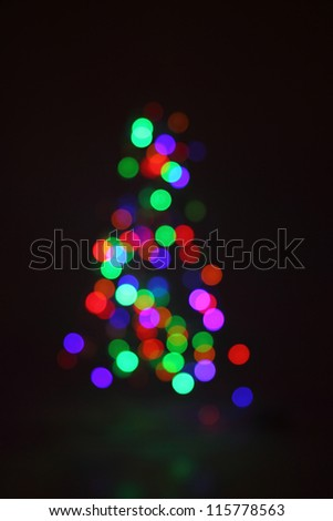 christmas tree from xmas color lights on the dark background