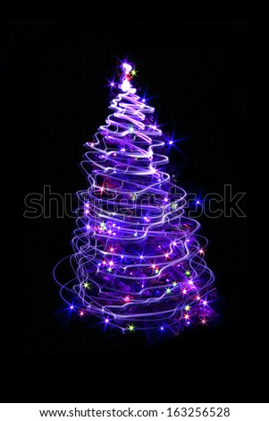 christmas tree frrom the bulb light on the black background - stock photo