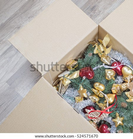christmas tree, glitter baubles and tinsel in the paper box