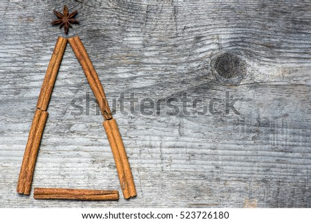 Christmas tree greeting card made cinnamon on wooden background