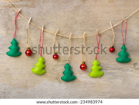christmas tree hanging over wooden background - stock photo