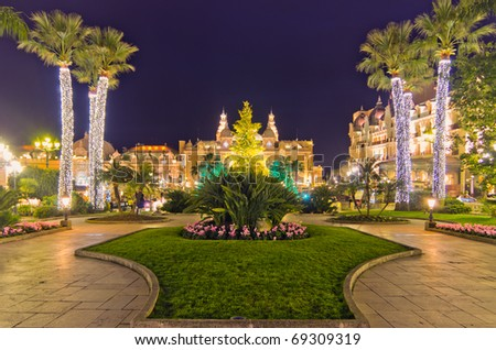 Christmas tree in front of the palace of casino of Monaco at dusk, Montecarlo, France