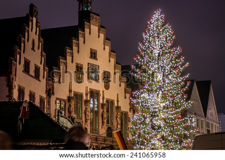 Christmas tree in historical center of Frankfurt, Germany, behind Roemer buildings at Roemerberg square. - stock photo