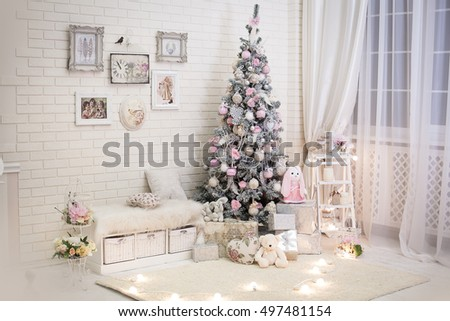 christmas tree in pink shabby chic style at the white brick wall background vintage clock