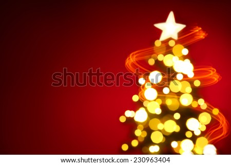 Christmas tree lights on red background - stock photo