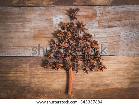 Christmas tree made of cinnamon and anise on old wood
