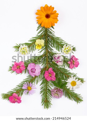 Christmas tree made of fir branches decorated with a variety of bright beautiful summer flowers on white background - stock photo