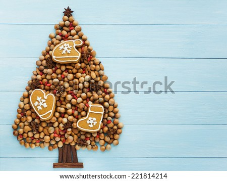 Christmas tree made of nuts, cinnamon and anise. Viewed from above.  - stock photo
