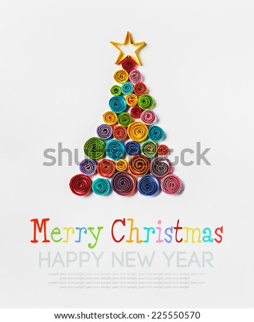 Christmas tree made of paper made by Quilling. inscription is a sample text for congratulation - stock photo