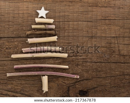 Christmas tree made of wooden branches - stock photo