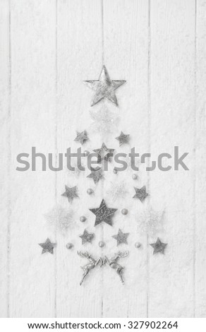 Christmas tree of a collection with white, silver and grey stars. - stock photo