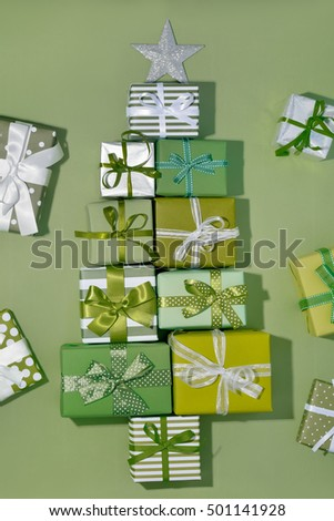 Christmas tree of gift boxes on green background