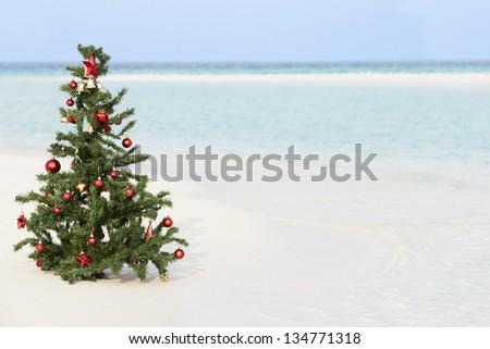 Christmas Tree On Beautiful Tropical Beach - stock photo