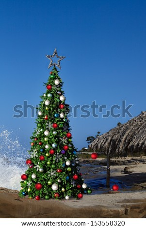 Christmas Tree On Beautiful Tropical Beach Thatched Palm Palapa House Decorated With Red & White Christmas Ornaments & Lights, Adventure Holiday Background With Blue Sky Copy Space For Text