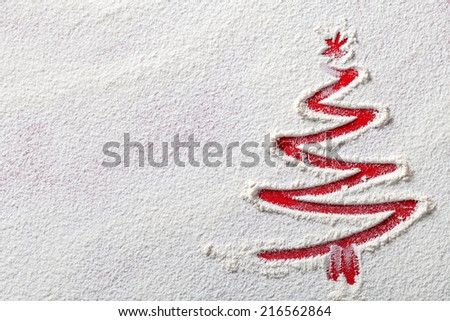 Christmas tree on flour background. White flour looks like snow. Top view