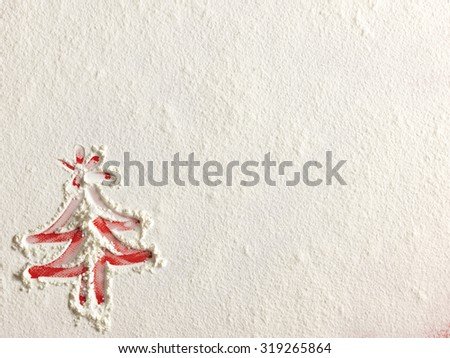Christmas tree on flour background. White flour looks like snow. Top view - stock photo