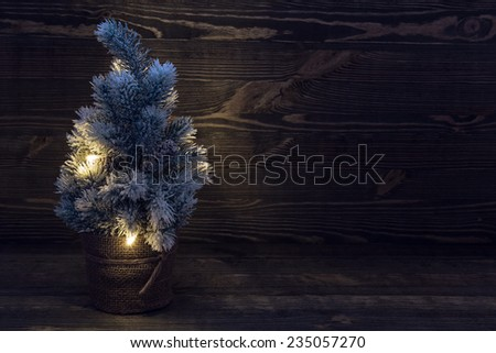 Christmas tree on the background of old wood - stock photo