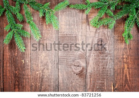 christmas tree on the old wooden background - stock photo