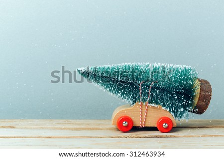 Christmas tree on toy car. Christmas holiday celebration concept - stock photo