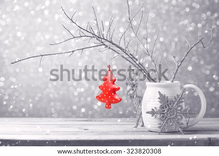 Christmas tree ornament hanging over bokeh background - stock photo