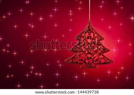Christmas tree ornament in with snow fall - stock photo
