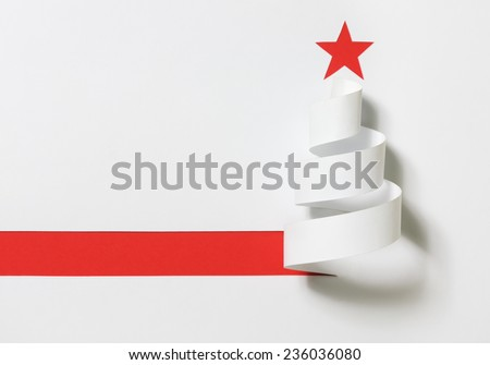 Christmas tree. Paper cut on a red background with shadow. - stock photo