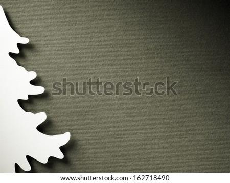 Christmas tree paper cutting design vintage monochrome card - stock photo