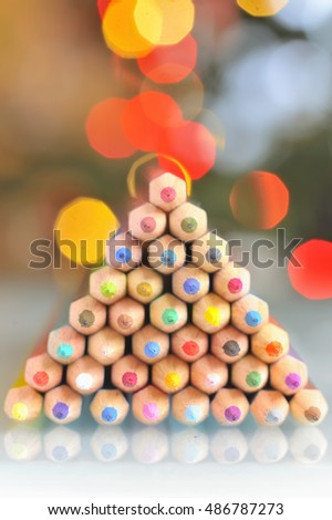 christmas tree pencils and bokeh  lights