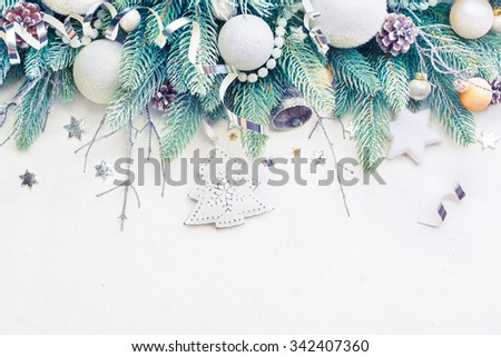 Christmas Tree Pine Branches and Christmas balls on a light background. Christmas Holiday background with copyspace - stock photo