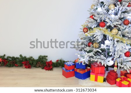 Christmas tree placed in the white room - stock photo