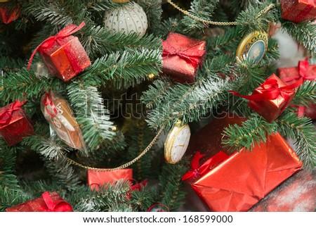Christmas tree retro style decoration of boxes and clocks - stock photo