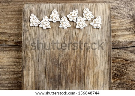 Christmas tree shape made of wood on wooden table. Christmas decor. - stock photo
