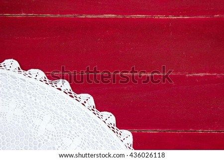 Christmas tree skirt on antique rustic red wood background; above view looking down  - stock photo