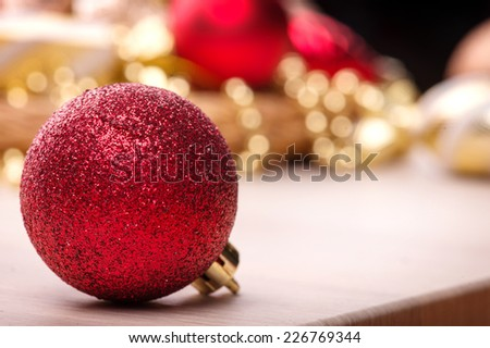 Christmas tree toy and  decoration like red ball  on wooden table with copy place close-up selective focus  - stock photo