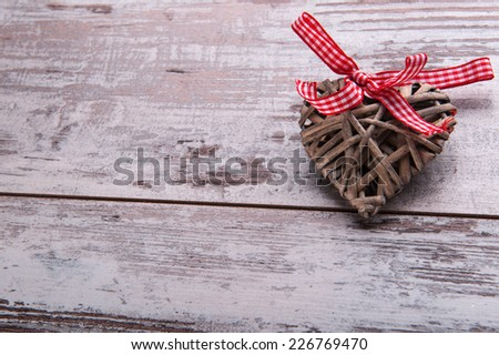 Christmas tree toy and  decoration like wicker wooden heart with red checked  bow on table top view with copy place  - stock photo