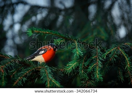 "Christmas tree toy "" bullfinch "" on a green spruce branch. Old Russian toy. - stock photo"