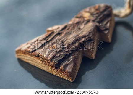 christmas tree toy made of pine bark - stock photo