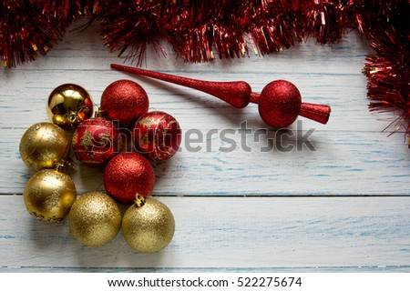 Christmas tree toys and shiny red garland on a white wooden background. New Year.