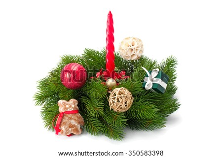 Christmas tree twigs and shiny balls ,candle and gingerbread isolated on white background - stock photo