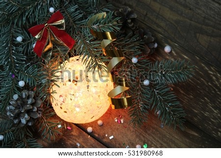 Christmas tree with a ball of burning garland