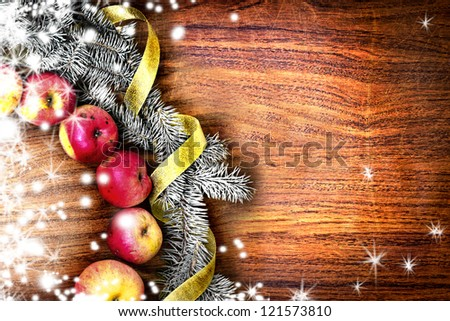 christmas tree with apples and decorations on a wooden board/Christmas card design featuring a home made christmas wreath on a rustic wooden wall /holidays background - stock photo