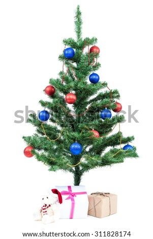 Christmas tree with baubles and gifts isolated on white background. - stock photo