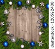 Christmas tree with baubles on wood texture. - stock photo