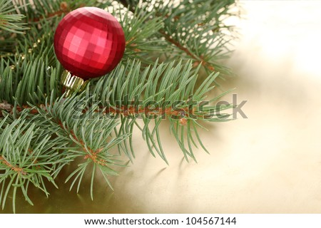 Christmas tree with beautiful New Year's ball on table - stock photo