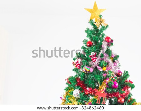 Christmas tree with colorful ornaments, on white background - stock photo