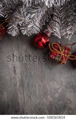 Christmas tree with decoration on dark stone background