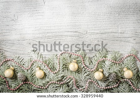 Christmas tree with decoration over old wooden background