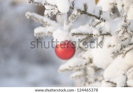 Christmas tree with decoration under snow - stock photo