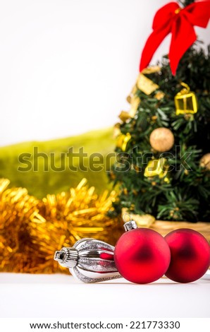 Christmas tree with decorations on a white background.